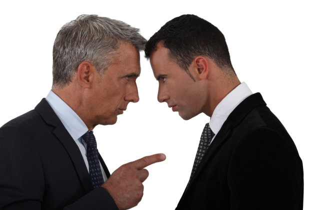 An older businessman goes head-to-head with a younger businessman.